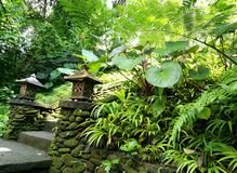 Traditional stone carved lanterns in Balinese garden stock images