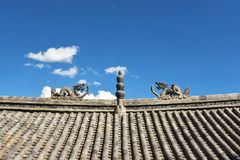 Traditional stone dragon decoration on the roof Stock Image