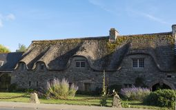 Traditional stone house with thatched roof in Brittany France . Brittany Normandy France royalty free stock image
