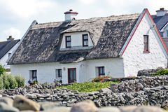 Traditional Irish house, Inisheer, Ireland. Traditional stone house with thatched roof, Inis Oirr, Aran Island, Ireland Stock Images