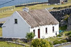 Traditional Irish house, Inisheer, Ireland. Traditional stone house with thatched roof, Inis Oirr, Aran Island, Ireland Stock Photos