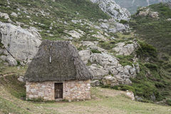 Traditional stone huts. With thatched roof in Saliencia Valley, Somiedo Nature Reserve. It is located in the central area of the Cantabrian Mountains in the Stock Photos