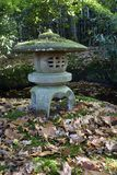 Traditional stone Japanese lantern in autumn Royalty Free Stock Photos