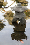 Traditional stone lamp in the lake. Japanese garden. Stock Image