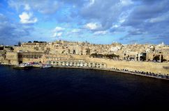 Coastline traditional architecture in Valletta,Malta. Traditional stone made buildings in ancient city Valletta,Malta with coastline,fishing ships and blue sky Stock Photography