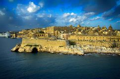 Coastline View at ancient city of Valletta,Malta. Traditional stone made buildings,fortress,coast,blue sky and clouds in Valletta,Malta in a summer time Royalty Free Stock Image