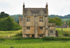 Traditional Stone Medieval English Village House. Set in a rural meadow Royalty Free Stock Images
