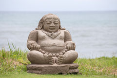 Traditional stone sculpture on the beach in Kuta, Bali, Indonesia Royalty Free Stock Image