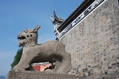 Traditional stone sculpture in front of temple in Sandouping stock photography