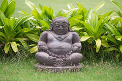 Traditional stone sculpture in garden .  Bali, Indonesia Royalty Free Stock Photos