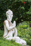 Traditional stone sculpture in garden . Island Bali, Ubud, Indonesia Royalty Free Stock Photography