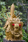 Traditional stone sculpture in garden . Island Bali, Ubud, Indonesia Royalty Free Stock Photo