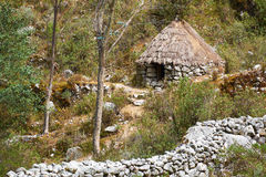 Traditional stone thatch hut Stock Photos