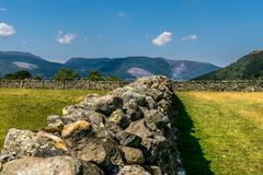 A traditional stone wall in a field leading into the distance. stock images