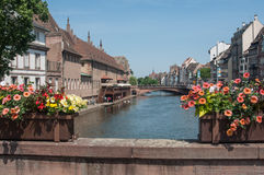 Traditional stoned bridge on IL river with flowers at little France quarter in Strasbourg Stock Photo