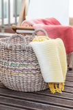Traditional straw basket with yellow blanket Stock Photography