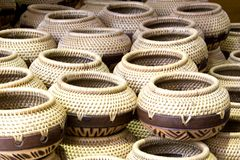 Traditional Straw Containers. Traditional containers made of straw and coconut shell Royalty Free Stock Images