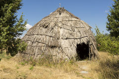 Traditional straw hut in greek country Royalty Free Stock Photos
