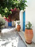 Traditional street among bougainvillaea in rethymno city Greece Royalty Free Stock Image