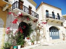 Traditional street among bougainvillaea in rethymno city Greece Royalty Free Stock Photos