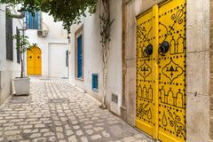 Street in a town in Tunisia. Traditional street with decorated doors in a Tunisian town royalty free stock images