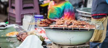 Traditional Street Food Cuisine, Thai Marinated Pork Skewers Moo Ping, Barbecue Pork Skewers, Grilled with bamboo sticks and oft stock photos