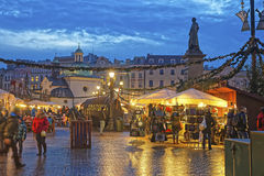 Traditional street market near Church of St Wojciech and Statue Stock Photo