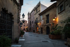 Traditional street of medieval Spanish village at Barcelona town, Catalonia, Spain Royalty Free Stock Images