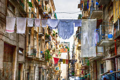 Traditional streets of Naples with hanging washing linen, Italy. Traditional streets of Naples with washing clothes Stock Photography