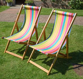 Traditional striped deck chairs Royalty Free Stock Images