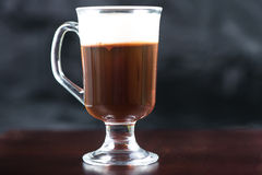 Traditional strong irish coffee on wooden bar Royalty Free Stock Image