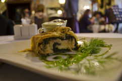 Traditional strudel of salmon with pesto sauce. ! Stock Photography