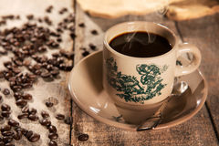 Traditional style Chinese coffee in vintage mug Stock Photos