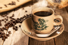 Traditional style Hainanese coffee in vintage mug Royalty Free Stock Images