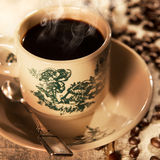 Traditional style Malaysian Chinese coffee in vintage mug Royalty Free Stock Images