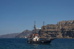 Sailing near caldera of Santorini stock image