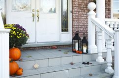 Traditional styled home decorated in autumn decore. Royalty Free Stock Images
