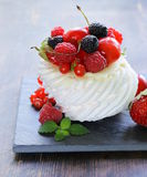 Traditional summer dessert pavlova with berries Royalty Free Stock Images