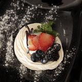 Traditional summer dessert pavlova with fresh berries Stock Images