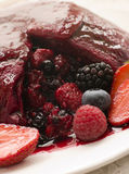 Traditional Summer Pudding with a scoop out Royalty Free Stock Photos