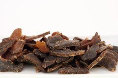 Traditional sun dried South African beef biltong meat. Biltong is a healthy low fat, high protein cured dry meat suitable for dieting using sun dried methods of Royalty Free Stock Photo