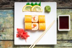 Traditional sushi rolls on white plate Stock Photo