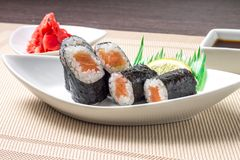 Traditional sushi served with wasabi and ginger Stock Photos