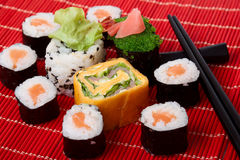 Traditional sushi Traditional sushi. Traditional sushi and chopstick on a red bamboo napkin. Series japanese food Stock Image