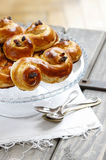 Traditional swedish buns on cake stand in christmas setting Stock Photos