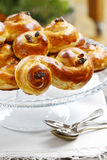 Traditional swedish buns on cake stand in christmas setting stock photo