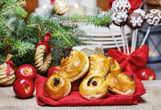 Traditional swedish buns in christmas setting. A saffron bun, royalty free stock photos