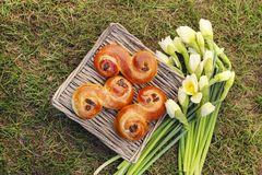 Traditional swedish buns in wicker basket. Garden party Royalty Free Stock Photography