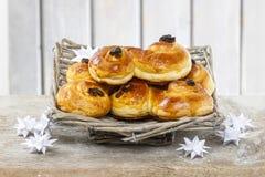 Traditional swedish buns in wicker basket. A saffron bun, in Swedish lussebulle or lussekatt Royalty Free Stock Photos