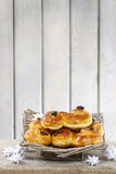 Traditional swedish buns in wicker basket. A saffron bun, in Swedish lussebulle or lussekatt. Copy space Royalty Free Stock Photo